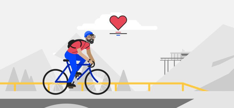 Home amb bicicleta en un carrer