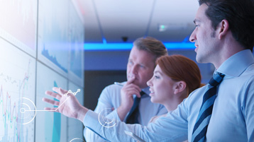 Bankovní odborníci pracující smoderními technologiemi