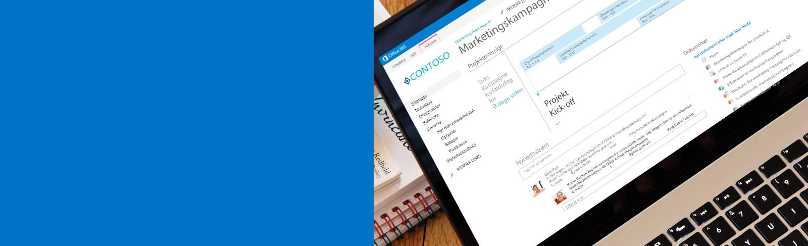 En bærbar pc med et dokument, der åbnes på SharePoint.
