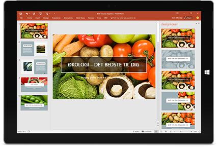 En tablet der viser funktionen Designer i en slide i en PowerPoint-præsentation.
