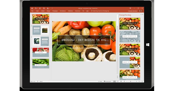 En tablet, der viser funktionen Designer i en slide i en PowerPoint-præsentation.
