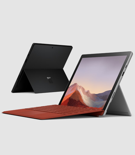 Surface Pro 7 med en Poppy Red Signature Type Cover