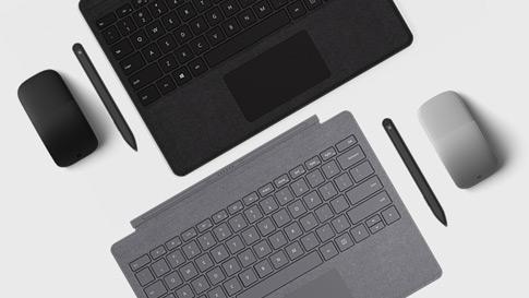 Nahaufnahme von Surface Pen und Surface Dial mit Surface Pro