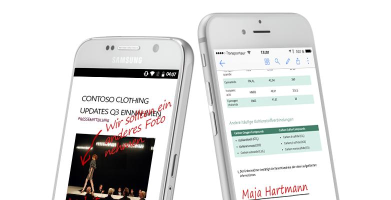 Zwei Smartphones mit Dokumenten und handschriftlichen Notizen
