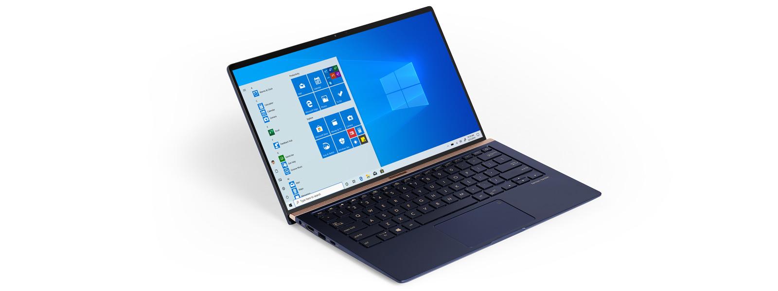 Ein blauer aufgeklappter Acer Swift 5 Laptop, der einen Windows 10 Startbildschirm anzeigt