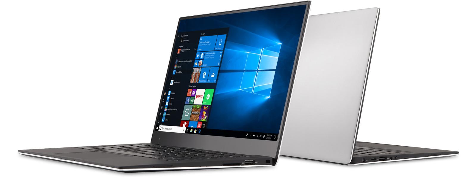 Zwei aneinander angelehnte Windows 10-Laptops