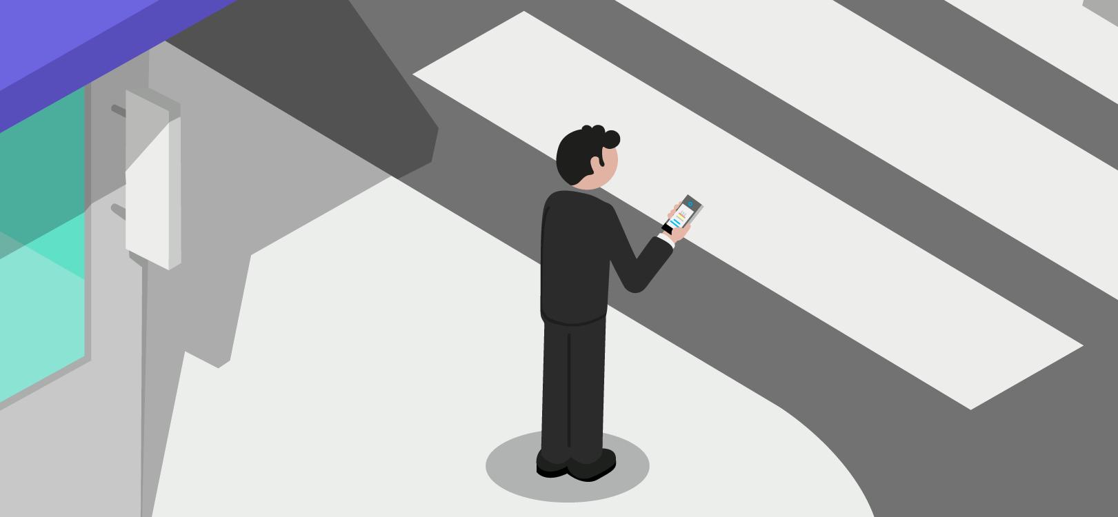 Mann auf einem Bürgersteig sieht ein Handy an