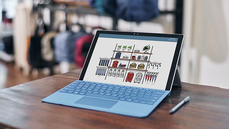 Surface Pro 4 mit Stift auf einem Tisch.