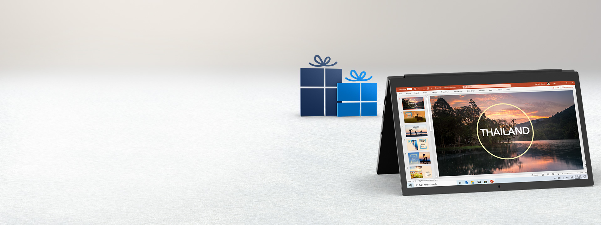 A PC surrounded by a holiday scene with a PowerPoint document open