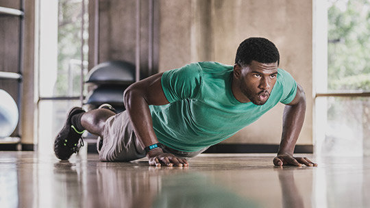 Man doing pushups, learn about the Microsoft Band