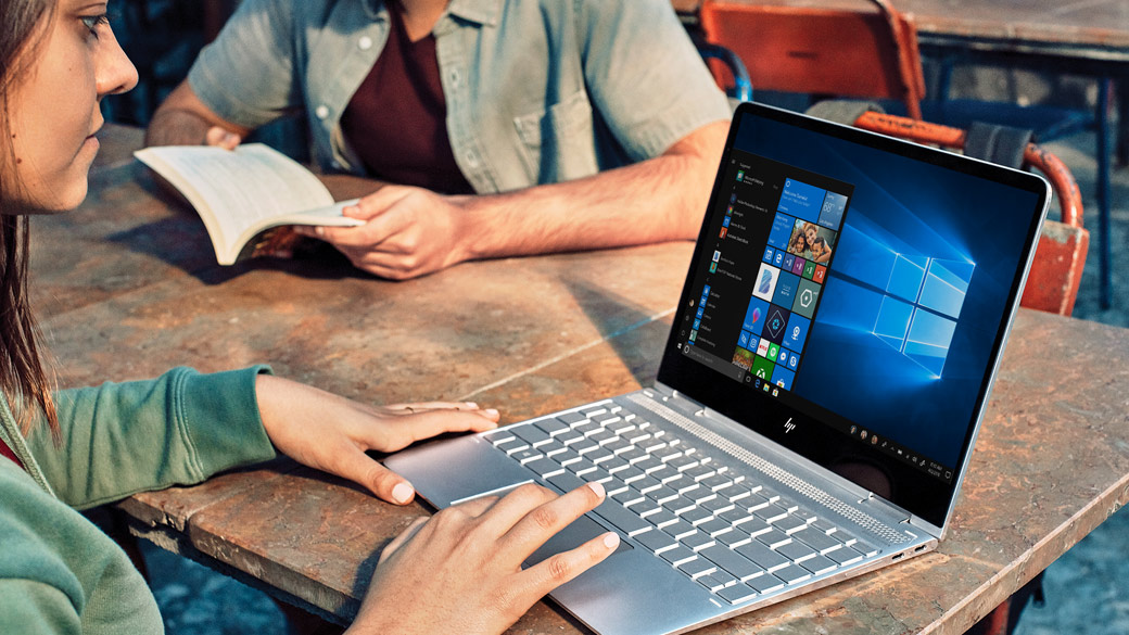 Woman using a Windows 10 laptop on table