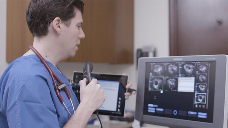 Doctor uses Surface tablet to look at MRI scans.