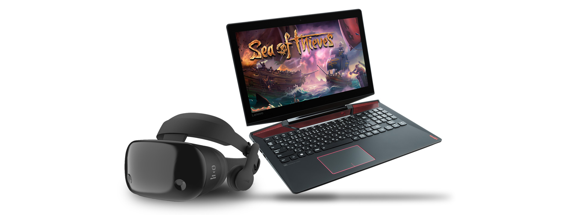 Windows Mixed Reality headset with a gaming laptop showing Sea of Thieves on the screen