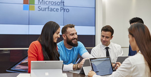 Microsoft store associate mentoring small business owners.
