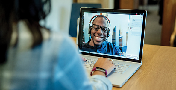 A customer is using Teams to live video call with a Microsoft Store employee.