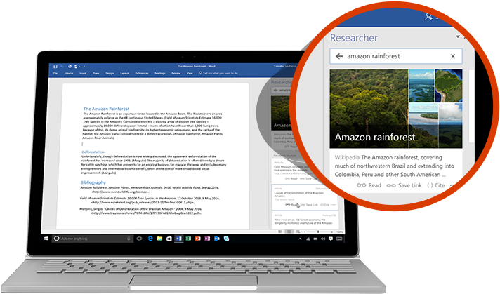 A laptop displaying a Word document and a close-up of the Researcher feature with an article about the Amazon rainforest
