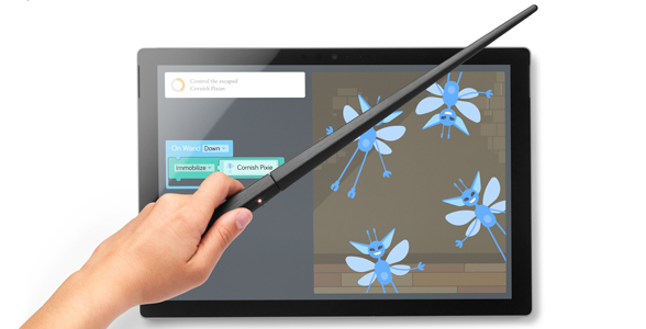 Harry Potter wand being waved over a Surface device.