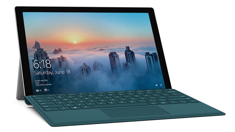 Teal Surface Pro 4 Type Cover attached to Surface Pro device, diagonal view, with city screenshot