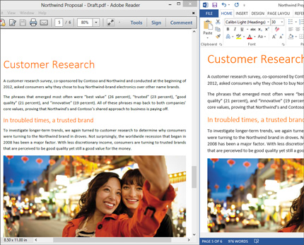 A laptop showing two different live layouts side by side of a single Word document.