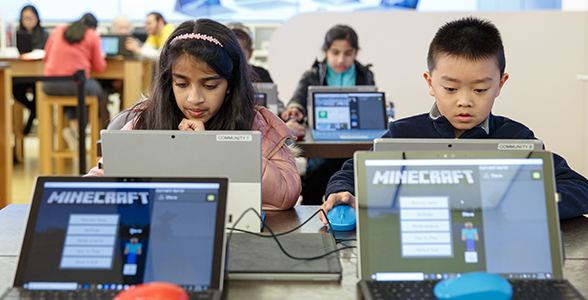 Children playing Minecraft in a workshop