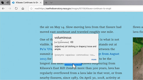 Microsoft Edge browser showing a written report about a volcanic eruption in Kilauea, with offline dictionary displaying definition of voluminous