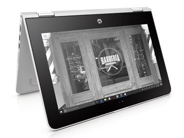HP Pavilion x360 in tent mode showing a photo of a storefront, owned by Marco.
