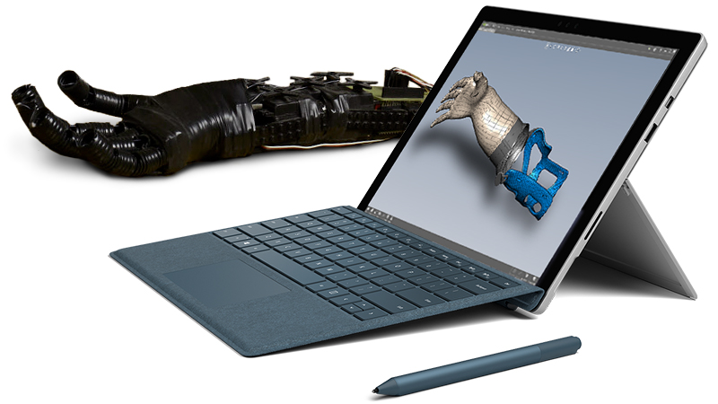 Surface Pro product image with Surface Pen and artificial limb design.