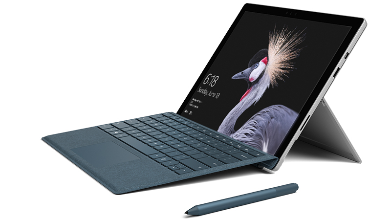 Surface Pro product image with Surface Pen and Surface Pro Signature Type Cover.