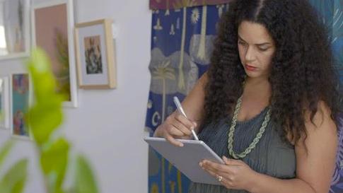 Woman using Surface Pro 4.
