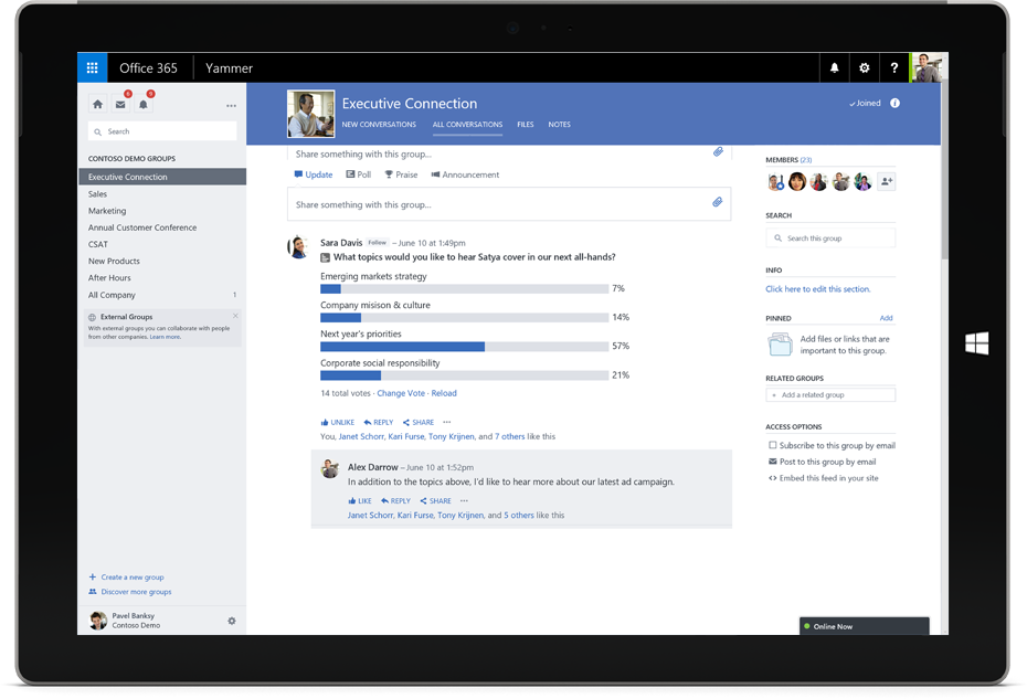 A Surface tablet displays a Yammer conversation with cross-team members