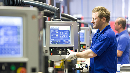 Workers in a factory, learn more about the Internet of Things