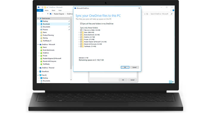 A laptop, showing a close-up of the OneDrive for Business sync feature