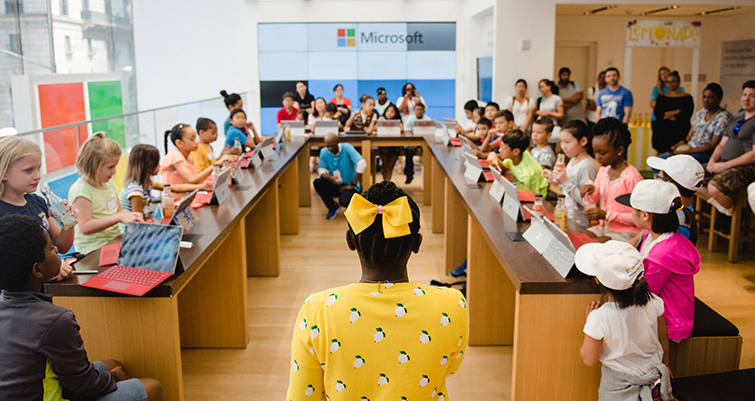 Mikala Ulmer presenting her story of entrepreneurship at Microsoft Store event.