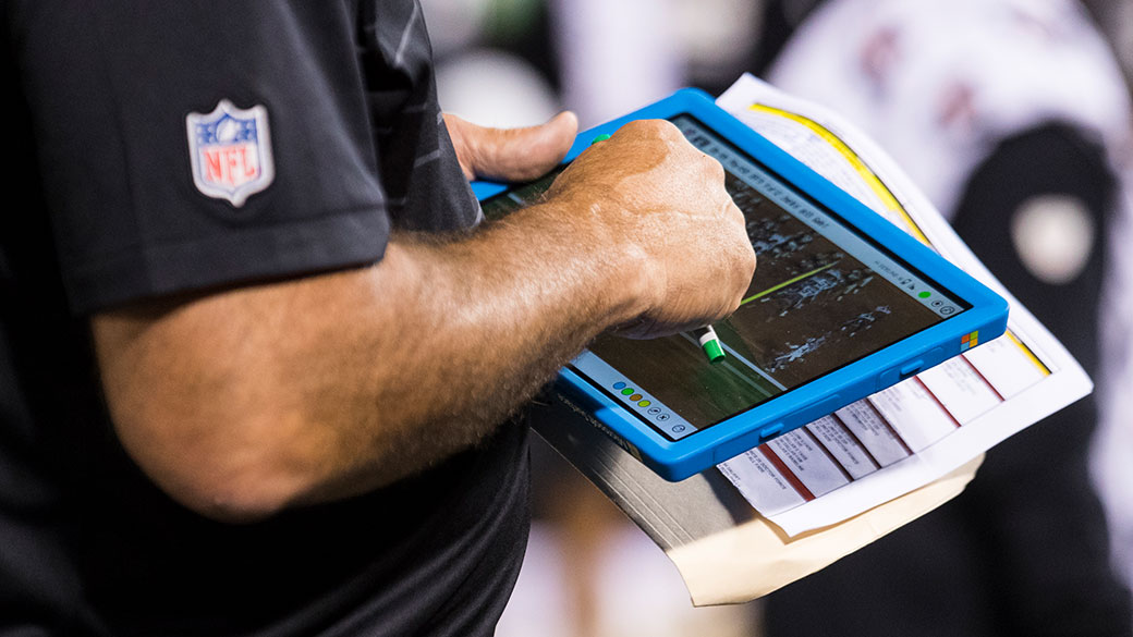 A Coach in the NFL uses a Surface Pro