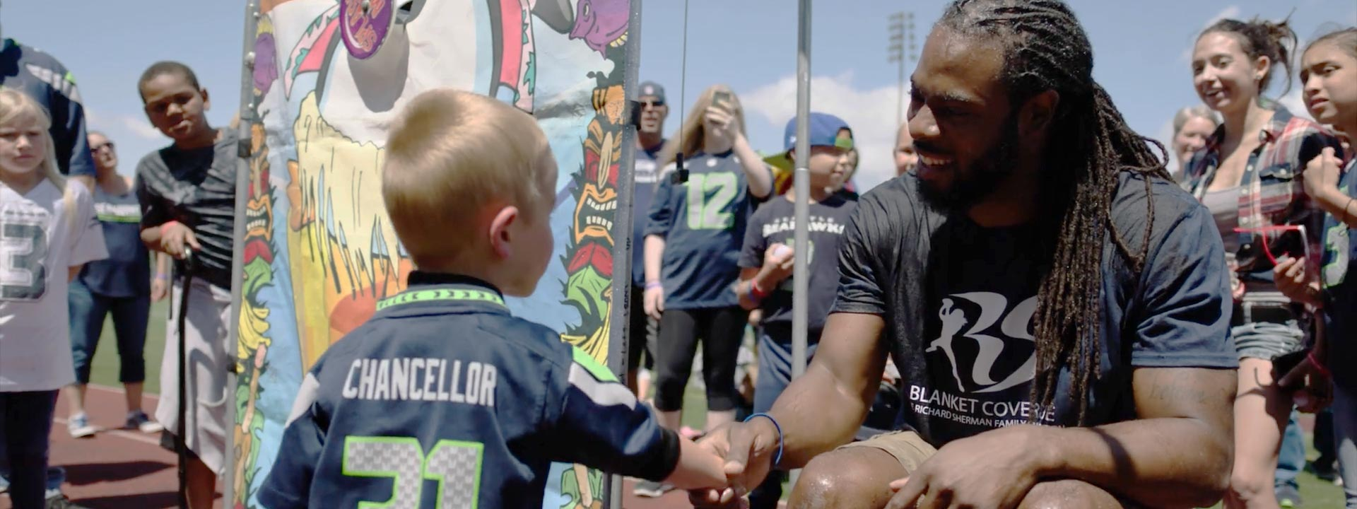 Richard Sherman provides students in low-income communities with school supplies and clothing through Blanket Coverage.