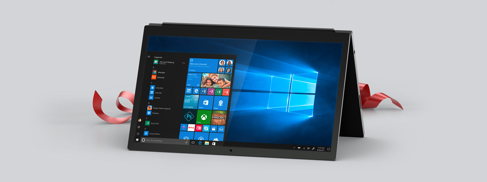 A Windows 10 PC in tent mode with a red ribbon behind it.