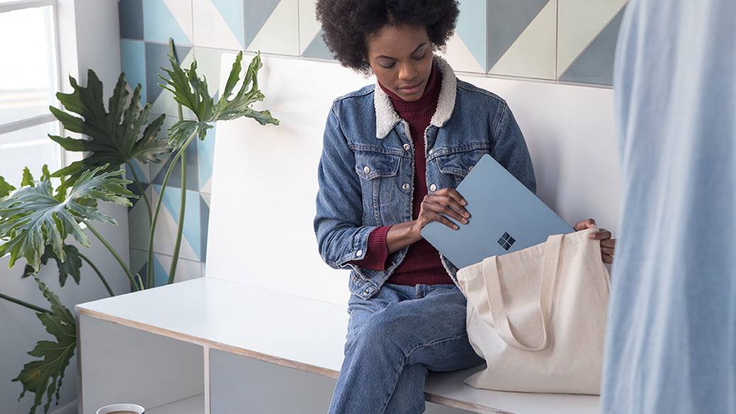 Woman holding Silver Surface Laptop