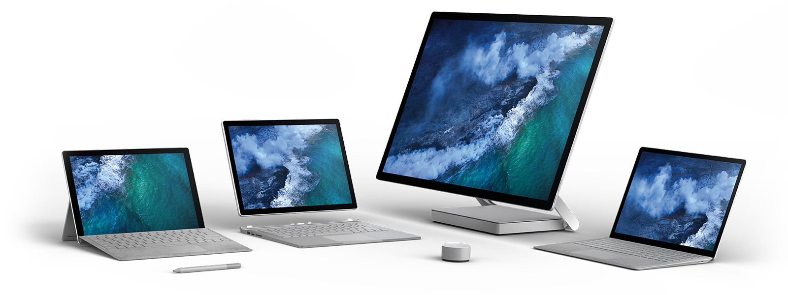 Surface Studio, Surface Book 2, Surface Laptop and Surface Pro side by side with Surface Pen and Surface Dial.
