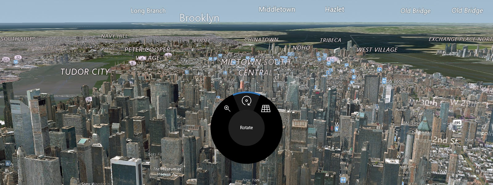 Detail of a Surface Dial control widget overlayed on an image of a cityscape