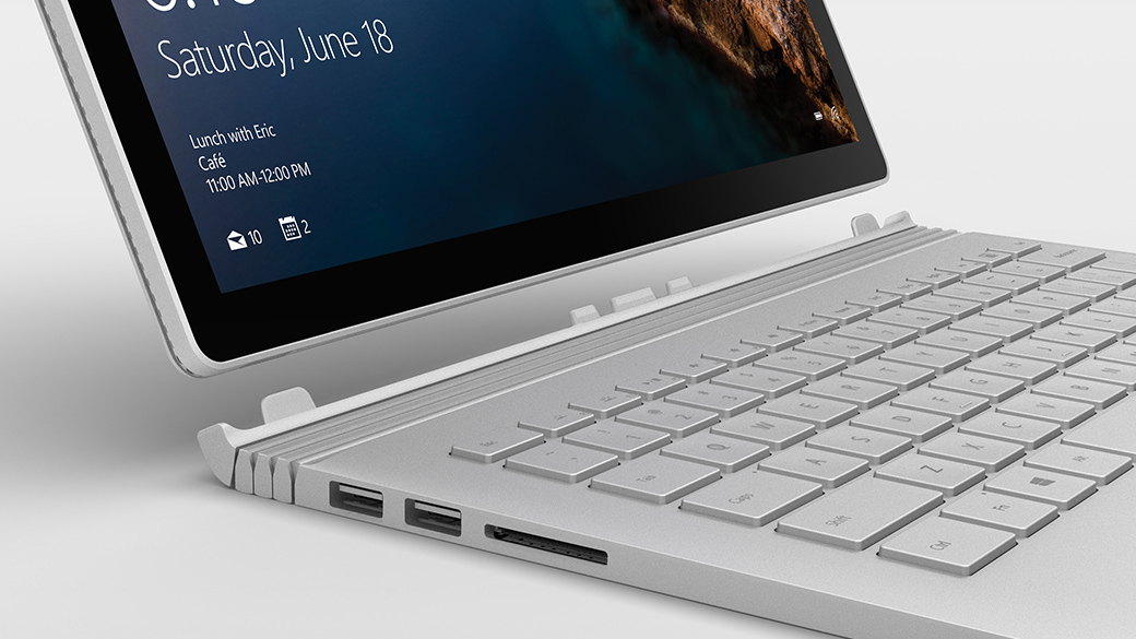 Surface Book shown as open laptop with Windows screen.