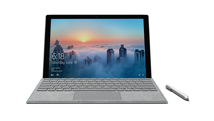Surface Pro 4 facing front with Surface Pen next to it