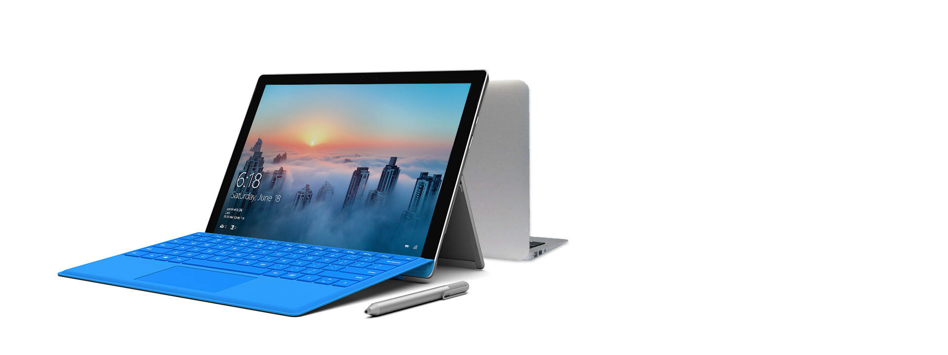 Surface Pro 4 and Macbook Pro positioned back-to-back with Surface Pen in the foreground
