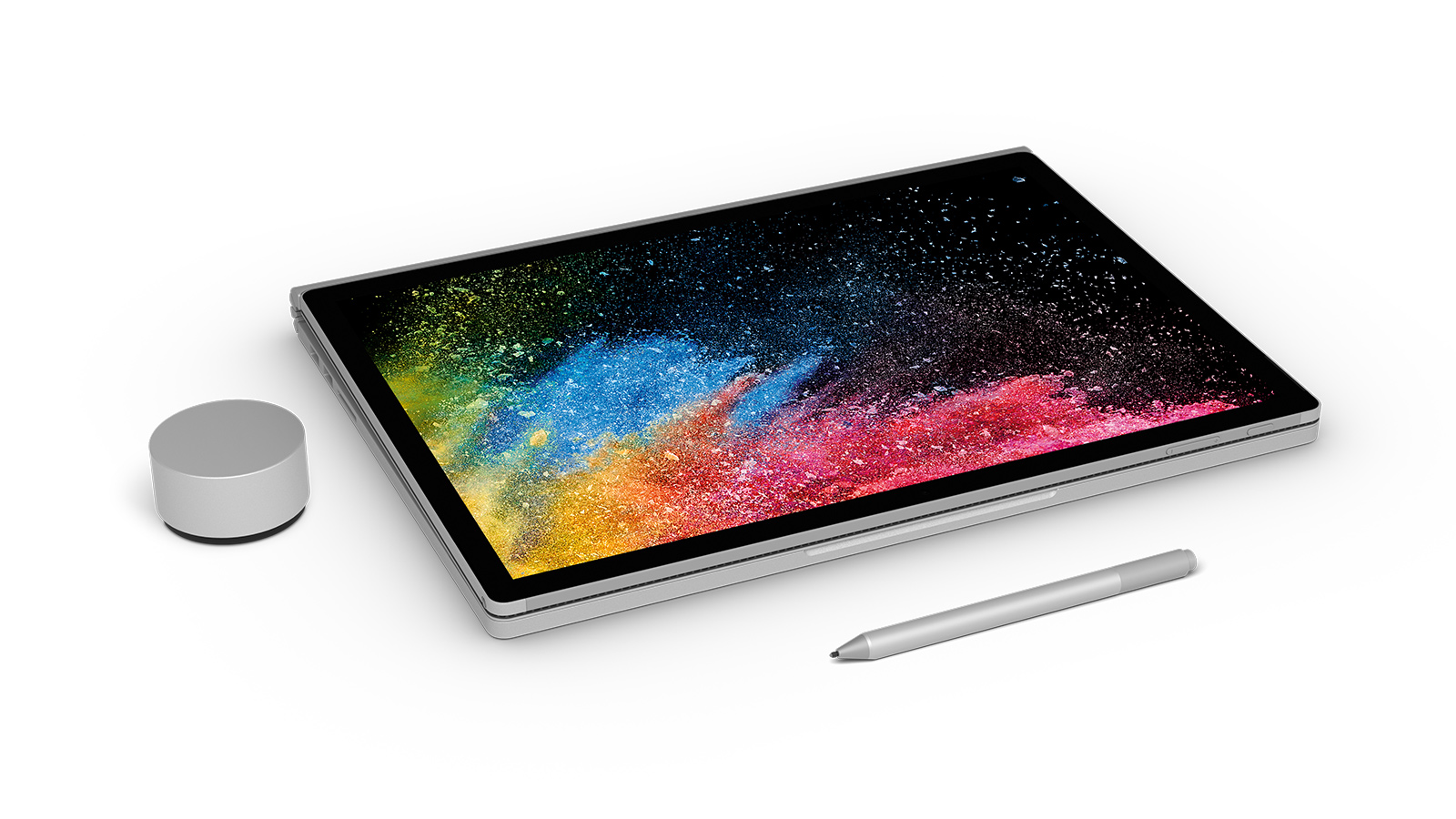 Surface Book 2 with start screen shown in clipboard mode with Surface Dial and Surface Pen.