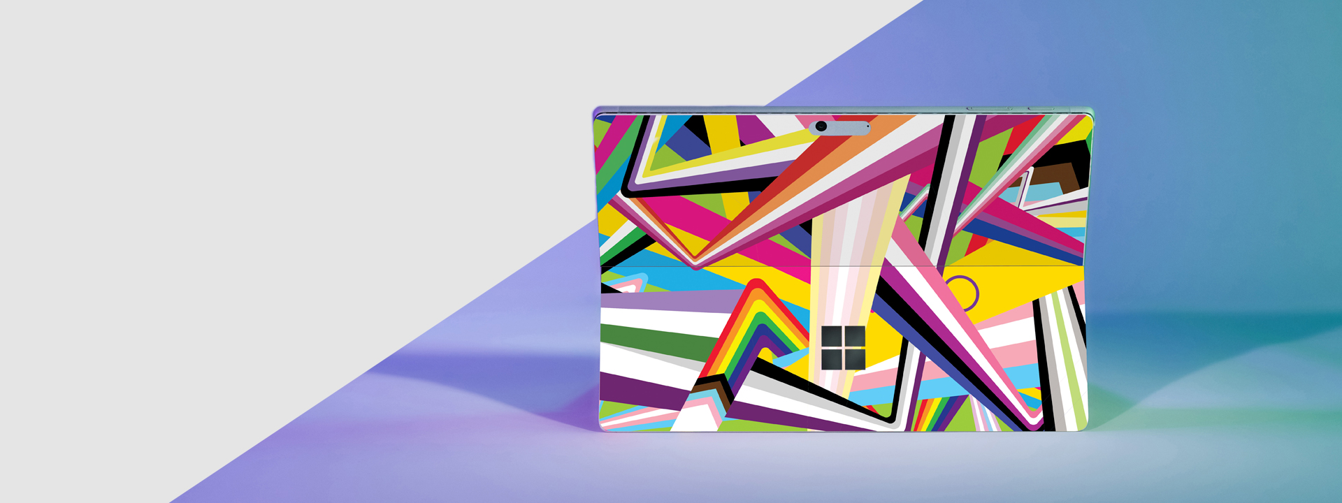 Image shows Microsoft Pride device cover featuring bright colorblocking