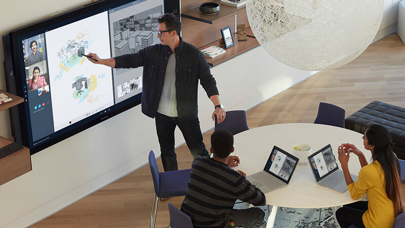 Man uses touch screen whiteboard in conference call