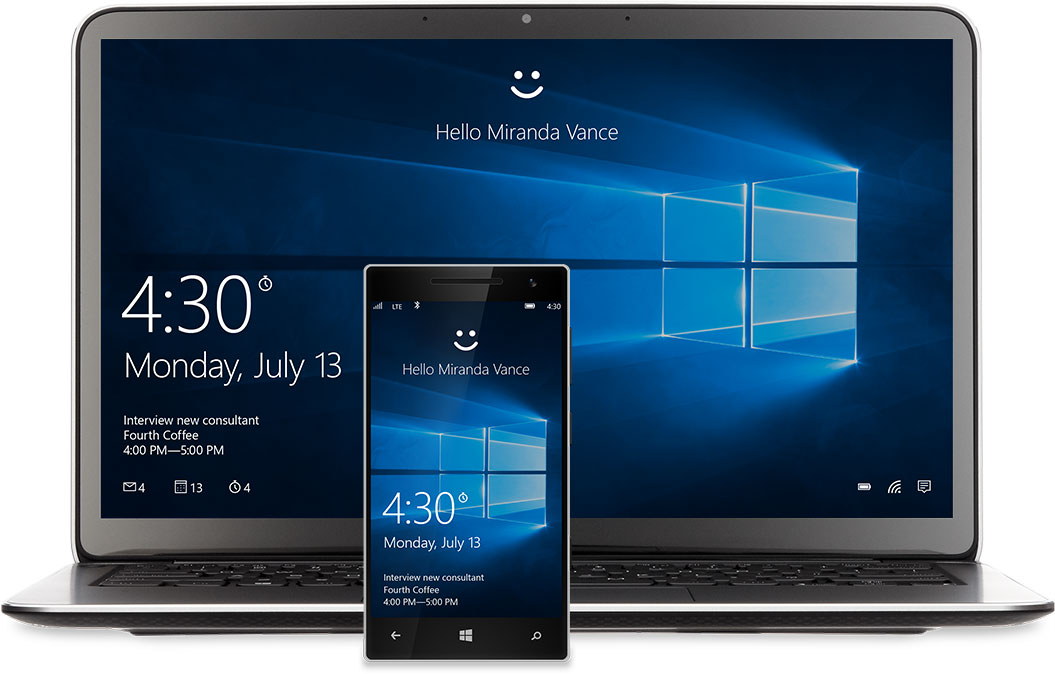 "A laptop and phone with the Windows 10 Start screen on the display. There's a smiley face at the top of each above the words, ""Hello Miranda Vance"""