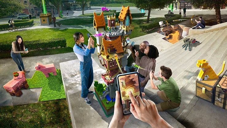 Group of people playing Minecraft Earth in a park.