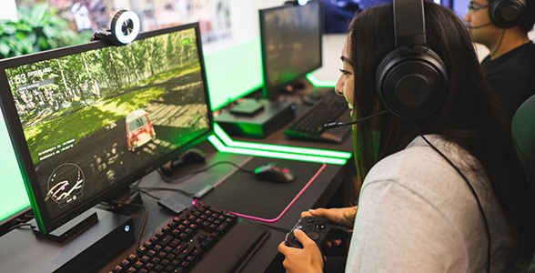 Female using controller to play computer game at Micrososft Store.