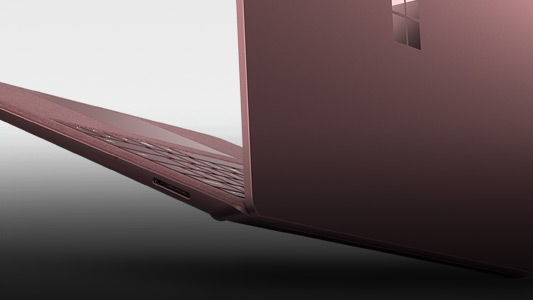 The back side of a burgundy Surface Laptop