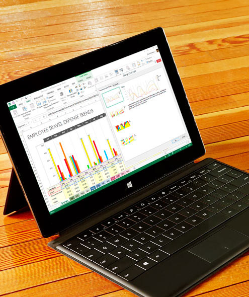 A tablet showing an Excel spreadsheet with a preview of recommended charts.